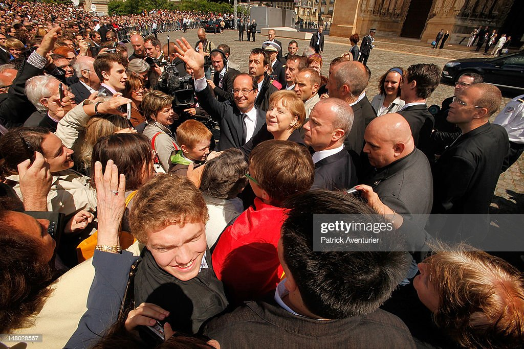 German Chancellor <a gi-track='captionPersonalityLinkClicked' href=/galleries/search?phrase=Angela+Merkel&family=editorial&specificpeople=202161 ng-click='$event.stopPropagation()'>Angela Merkel</a> and French President Francois Hollande attend a ceremony to celebrate 50 years of French and German reconciliation, on July 8, 2012 in Reims, France. The leaders are meeting on the 50th anniversary of the historic meeting of the French President Charles de Gaulle and German Chancellor Konrad Adenauer, who in 1962 met at the cathedral and forged a new era of friendship in post-World War II Franco-German relations. Merkel and Hollande are also seeking common ground despite their policy differences in seeking a solution to the current Eurozone debt crisis.