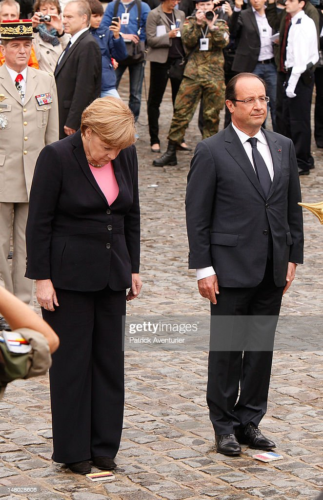 German Chancellor Angela Merkel and French President Francois Hollande attend a ceremony to celebrate 50 years of French and German reconciliation, on July 8, 2012 in Reims, France. The leaders are meeting on the 50th anniversary of the historic meeting of the French President Charles de Gaulle and German Chancellor Konrad Adenauer, who in 1962 met at the cathedral and forged a new era of friendship in post-World War II Franco-German relations. Merkel and Hollande are also seeking common ground despite their policy differences in seeking a solution to the current Eurozone debt crisis.