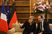 German Chancellor Angela Merkel and French President Francois Hollande attend a reception for French and German cultural representatives at the...