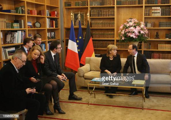 German Chancellor Angela Merkel and French President Francois Hollande attend a reception for French and German cultural representatives including...
