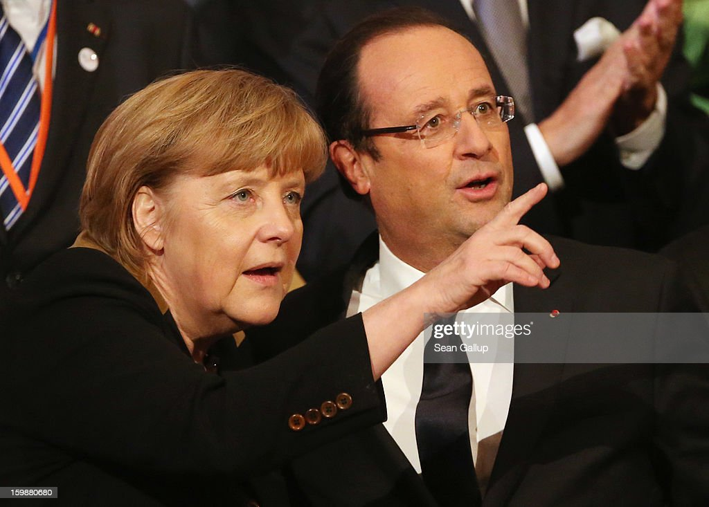German Chancellor <a gi-track='captionPersonalityLinkClicked' href=/galleries/search?phrase=Angela+Merkel&family=editorial&specificpeople=202161 ng-click='$event.stopPropagation()'>Angela Merkel</a> and French President Francois Hollande attend a concert at the Berlin Philharmonic during the 50th anniversary celebration of the Elysee Treaty on January 22, 2013 in Berlin, Germany. The treaty, concluded in 1963 by Charles de Gaulle and Konrad Adenauer in the Elysee Palace in Paris, set a new tone of reconciliation between France and Germany, and called for consultations between the two countries to come to a common stance on policies affecting the most important partners in Europe as well as the rest of the region. Since its establishment, the document for improved bilateral relations has been seen by many as the driving force behind European integration.