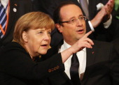German Chancellor Angela Merkel and French President Francois Hollande attend a concert at the Berlin Philharmonic during the 50th anniversary...