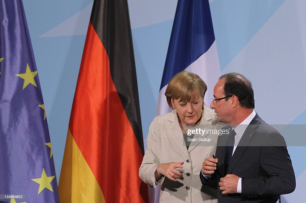 German Chancellor Angela Merkel and French President Francois Hollande depart after speaking to the media following talks at the Chancellery hours after Hollande's inauguration in Paris on May 15, 2012 in Berlin, Germany. Hollande has come to Berlin to discuss the current European debt crisis with Merkel and most importantly to find common ground, as he hopes to resolve the crisis with measures that mark a departure from the austerity packages favoured by Merkel.