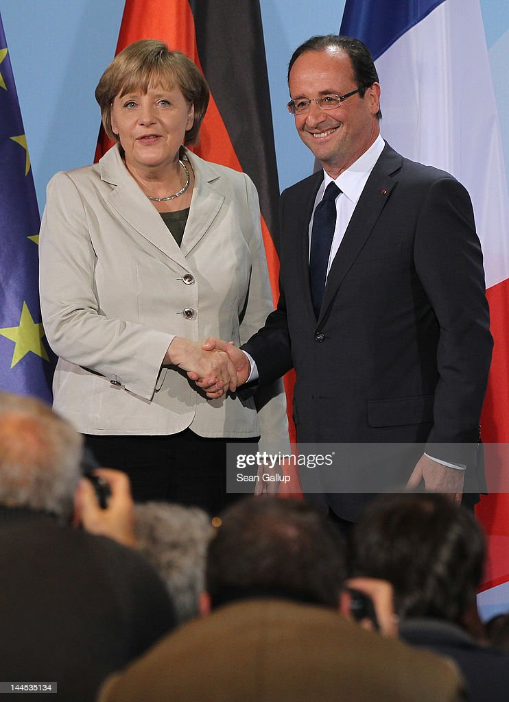 German Chancellor <a gi-track='captionPersonalityLinkClicked' href=/galleries/search?phrase=Angela+Merkel&family=editorial&specificpeople=202161 ng-click='$event.stopPropagation()'>Angela Merkel</a> and French President Francois Hollande depart after speaking to the media following talks at the Chancellery hours after Hollande's inauguration in Paris on May 15, 2012 in Berlin, Germany. Hollande has come to Berlin to discuss the current European debt crisis with Merkel and most importantly to find common ground, as he hopes to resolve the crisis with measures that mark a departure from the austerity packages favoured by Merkel.