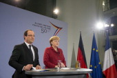 German Chancellor Angela Merkel and French President Francois Hollande give a speech to German and French students trainees and young workers on the...
