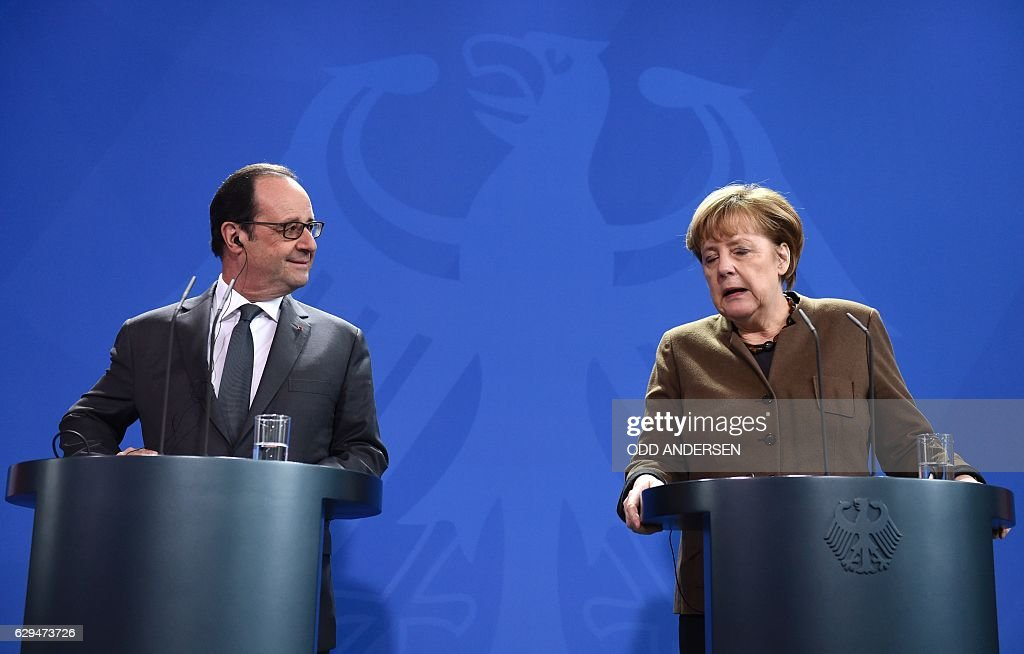 German Chancellor Angela Merkel and French President Francois Hollande give a joint press conference on December 13, 2016 at the Chancellery in Berlin. / AFP / ODD