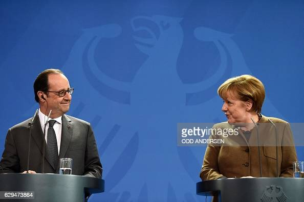TOPSHOT German Chancellor Angela Merkel and French President Francois Hollande give a joint press conference on December 13 2016 at the Chancellery...
