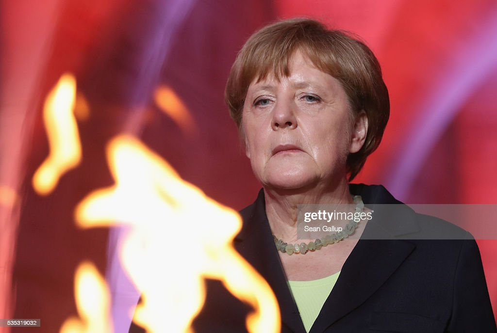German Chancellor <a gi-track='captionPersonalityLinkClicked' href=/galleries/search?phrase=Angela+Merkel&family=editorial&specificpeople=202161 ng-click='$event.stopPropagation()'>Angela Merkel</a> and French President Francois Hollande (not pictured) look on after lighting an eternal flame inside the ossuary at Douaumont in memory of the 130,000 soldiers whose remains are buried at the site during ceremonies to commemorate the 100th anniversary of the World War I Battle of Verdun on May 29, 2016 near Verdun, France. The 1916, 10-month battle pitted the French and German armies against one another in a grueling campaign of trench warfare and artillery bombardments that killed a total of approximately 300,000 soldiers. The events today coincide with the 50th anniversary of commemorations held at Verdun by then French President Charles de Gaulle and German Chancellor Konrad Adenauer that paved the way for a new era of peaceful, post-war Franco-German relations.