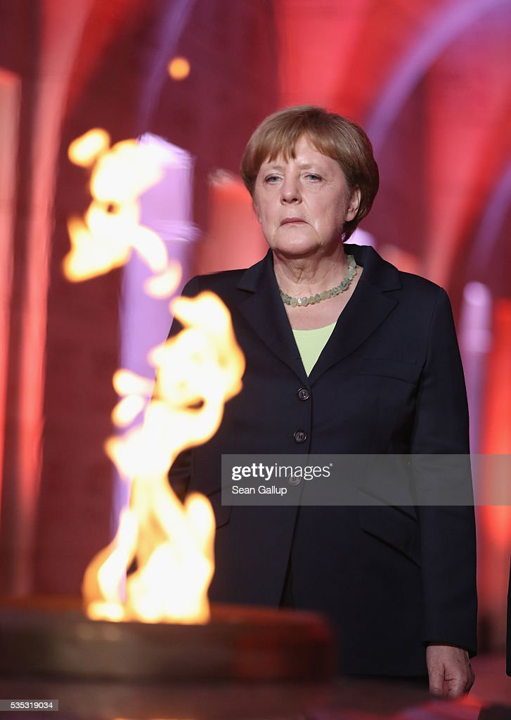 German Chancellor Angela Merkel and French President Francois Hollande (not pictured) look on after lighting an eternal flame inside the ossuary at Douaumont in memory of the 130,000 soldiers whose remains are buried at the site during ceremonies to commemorate the 100th anniversary of the World War I Battle of Verdun on May 29, 2016 near Verdun, France. The 1916, 10-month battle pitted the French and German armies against one another in a grueling campaign of trench warfare and artillery bombardments that killed a total of approximately 300,000 soldiers. The events today coincide with the 50th anniversary of commemorations held at Verdun by then French President Charles de Gaulle and German Chancellor Konrad Adenauer that paved the way for a new era of peaceful, post-war Franco-German relations.