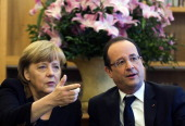 German Chancellor Angela Merkel and French President Francois Hollande meet at the French Embassy in Berlin on January 22 2013 for a meeting as part...
