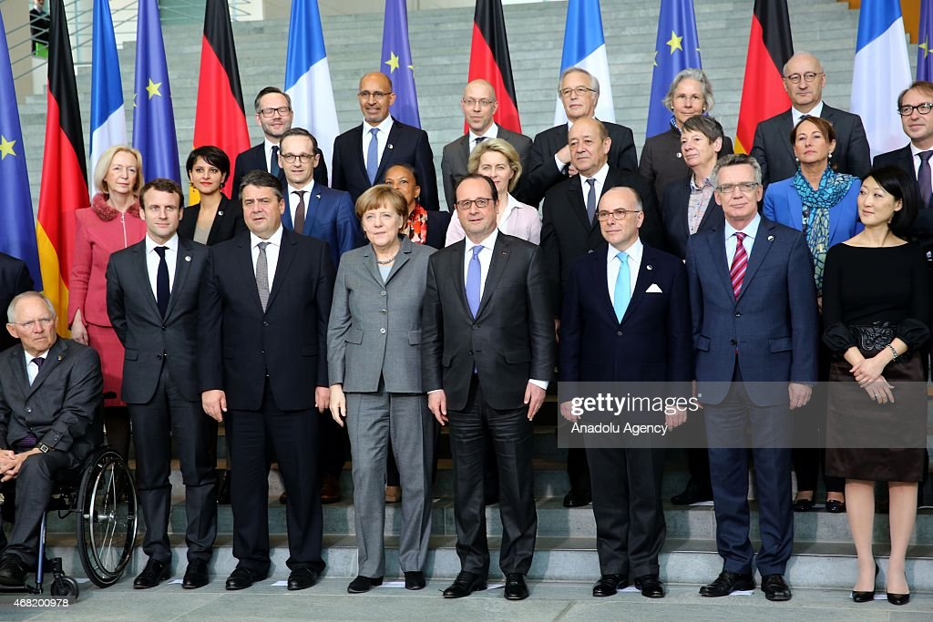 German Chancellor Angela Merkel and French President Francois Hollande pose for a photo in front of the Chancellery in Berlin Germany on March 31...