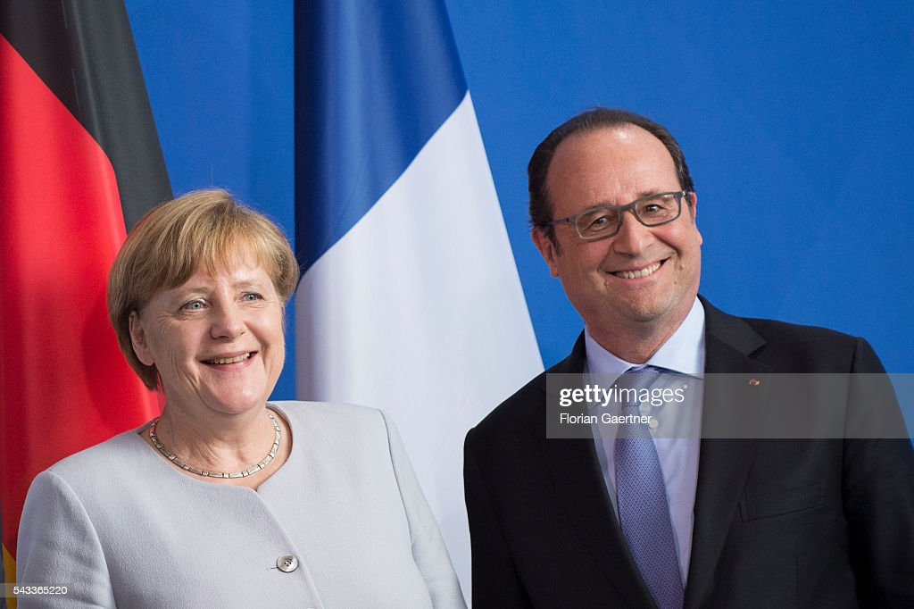 German Chancellor Angela Merkel and French President Francois Hollande smile during a press conference on June 27, 2016 in Berlin, Germany. Merkel hosted talks with Hollande and Renzi to discuss the UK's decision to leave the European Union.