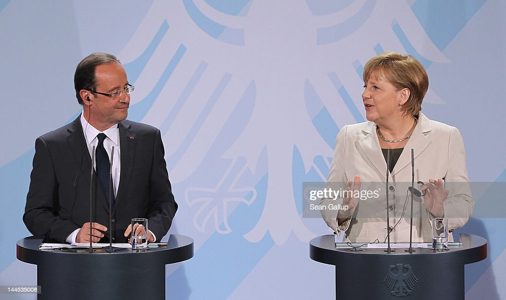 German Chancellor <a gi-track='captionPersonalityLinkClicked' href=/galleries/search?phrase=Angela+Merkel&family=editorial&specificpeople=202161 ng-click='$event.stopPropagation()'>Angela Merkel</a> and French President Francois Hollande speak to the media following talks at the Chancellery hours after Hollande's inauguration in Paris on May 15, 2012 in Berlin, Germany. Hollande has come to Berlin to discuss the current European debt crisis with Merkel and most importantly to find common ground, as he hopes to resolve the crisis with measures that mark a departure from the austerity packages favoured by Merkel.