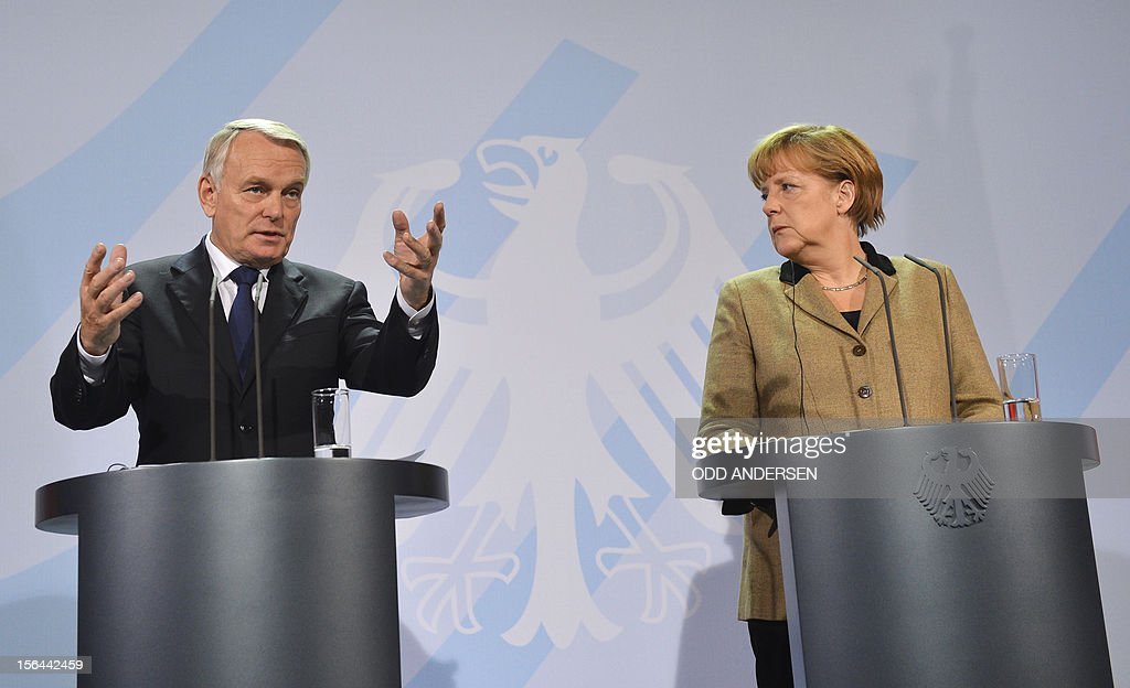 German Chancellor Angela Merkel (R) and French Prime Minister Jean-Marc Ayrault address a press conference at the chancellery in Berlin on November 15, 2012. Ayrault is on his first official trip to Germany, seeking to smooth tensions over economic policy between the two neighbours which have historically driven Europe forward. AFP PHOTO / ODD ANDERSEN