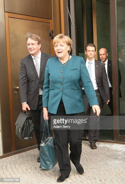 German Chancellor Angela Merkel and German Chancellery Chief of Staff Ronald Pofalla leave the first talks between the German Social Democrats and...