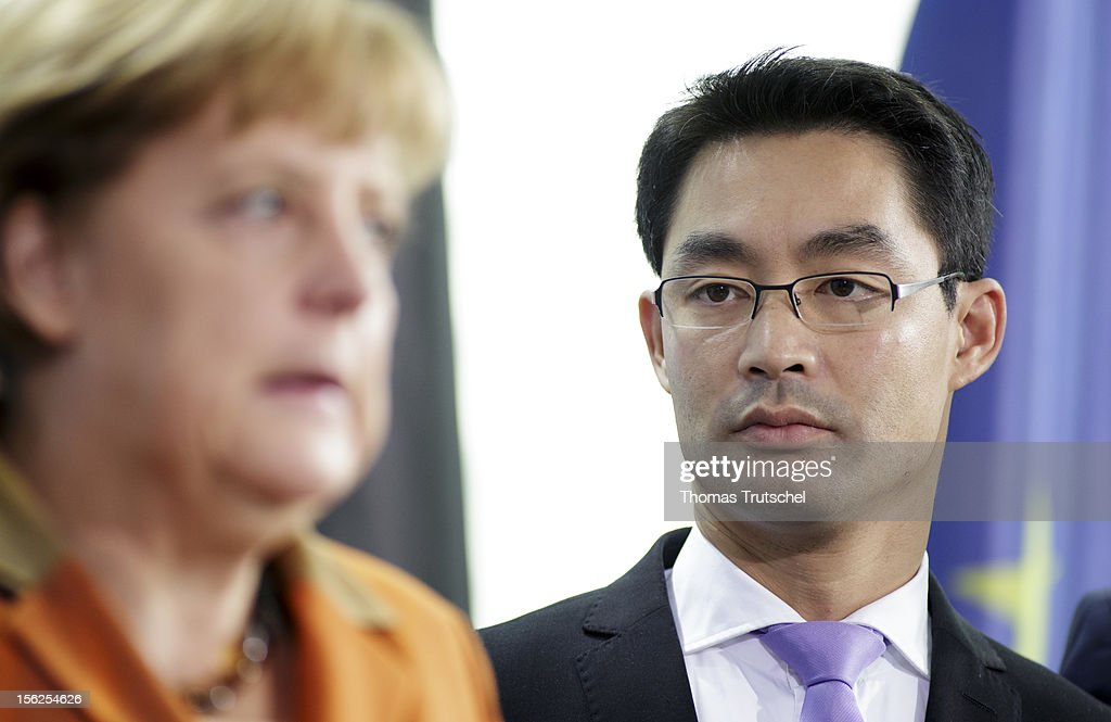German Chancellor <a gi-track='captionPersonalityLinkClicked' href=/galleries/search?phrase=Angela+Merkel&family=editorial&specificpeople=202161 ng-click='$event.stopPropagation()'>Angela Merkel</a>, and German Economy Minister and Vice Chancellor Philipp Roesler are pictured at chancellery on November 06, 2012.