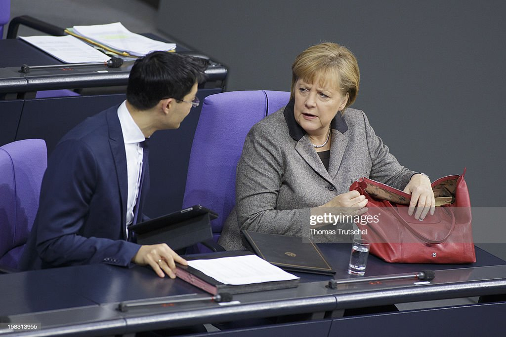 German Chancellor <a gi-track='captionPersonalityLinkClicked' href=/galleries/search?phrase=Angela+Merkel&family=editorial&specificpeople=202161 ng-click='$event.stopPropagation()'>Angela Merkel</a> and German Economy Minister and Vice Chancellor <a gi-track='captionPersonalityLinkClicked' href=/galleries/search?phrase=Philipp+Roesler&family=editorial&specificpeople=4838791 ng-click='$event.stopPropagation()'>Philipp Roesler</a> are pictured at Reichstag, the seat of the German Parliament (Bundestag) on December 13, 2012 in Berlin, Germany. Merkel gives a government declaration on the upcoming European Council meeting.