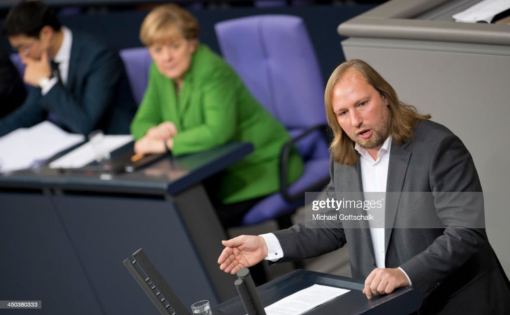 German Chancellor <a gi-track='captionPersonalityLinkClicked' href=/galleries/search?phrase=Angela+Merkel&family=editorial&specificpeople=202161 ng-click='$event.stopPropagation()'>Angela Merkel</a> and German Economy Minister and Vice Chancellor <a gi-track='captionPersonalityLinkClicked' href=/galleries/search?phrase=Philipp+Roesler&family=editorial&specificpeople=4838791 ng-click='$event.stopPropagation()'>Philipp Roesler</a> look on as Green Party of Germany co-leader Anton Hofreiter talks during a plenary session in German Bundestag on November 18, 2013 in Berlin, Germany. The Bundestag debates the activities in Germany of the US-Intelligence Service NSA.