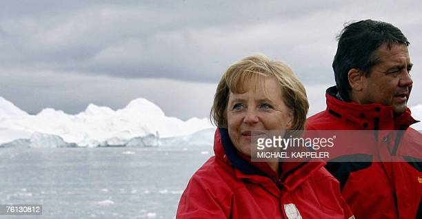 German Chancellor Angela Merkel and German Environment Minister Sigmar Gabriel are pictured 16 August 2007 during a round trip on a fjord near...