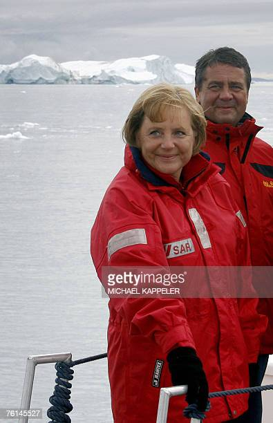 German Chancellor Angela Merkel and German Environment Minister Sigmar Gabriel are pictured onboard a boat navigating through a fjord near Ilulissat...