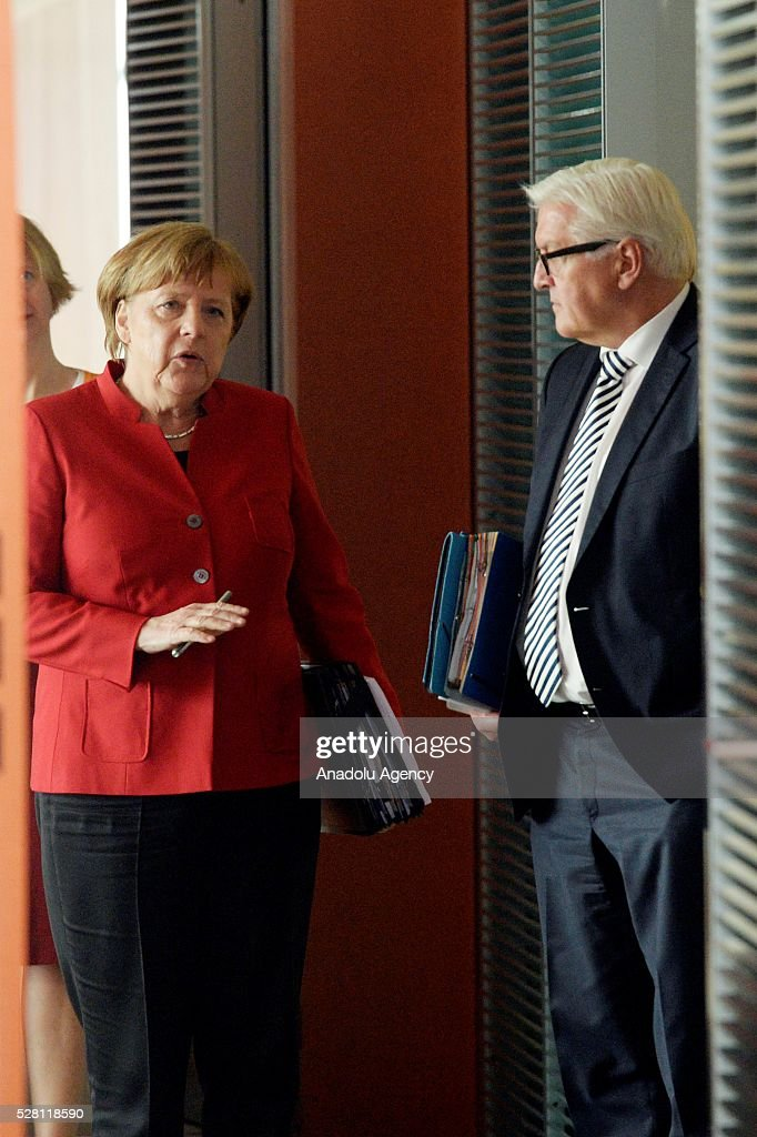 German Chancellor Angela Merkel (L) and German Foreign Minister Frank-Walter Steinmeier (R) attend the weekly cabinet meeting at the Chancellery in Berlin, Germany on May 04, 2016.