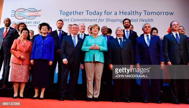 German Chancellor Angela Merkel and German Health Minister Hermann Groehe pose with Health Ministers for a family photo ahead the G20 meeting of...