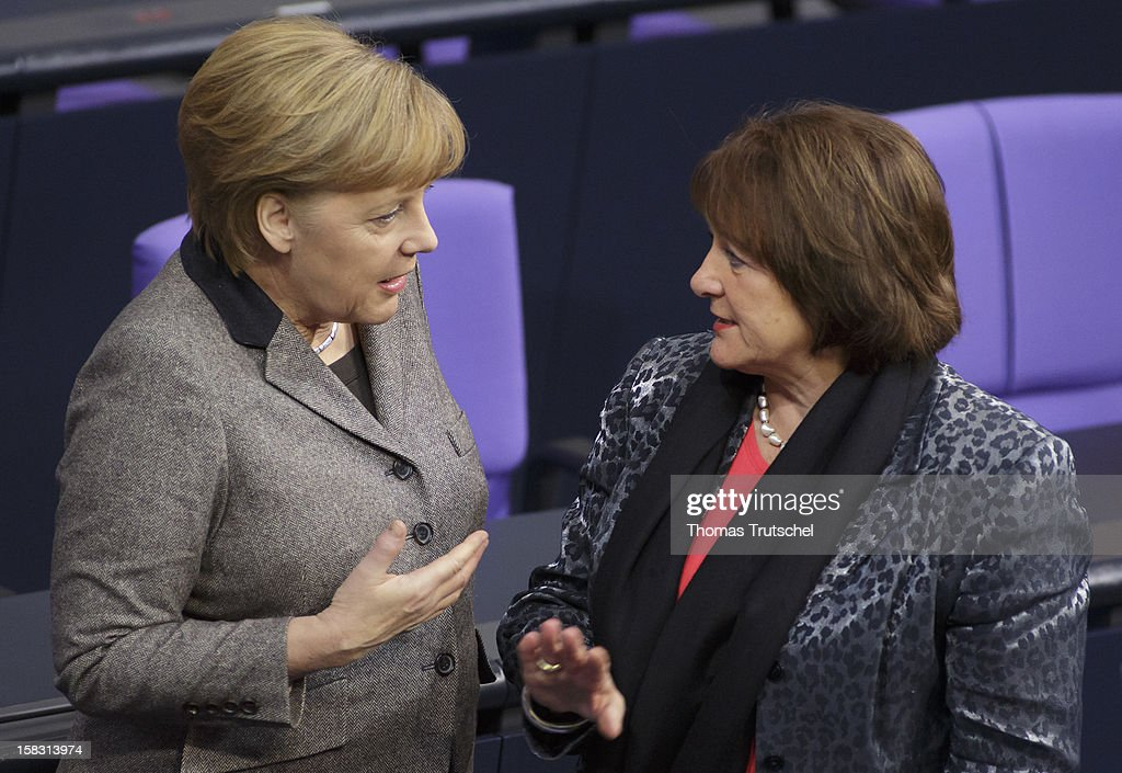 German Chancellor Angela Merkel (L), and German Justice Minister Sabine Leutheusser-Schnarrenberger are pictured at Reichstag, the seat of the German Parliament (Bundestag) on December 13, 2012 in Berlin, Germany.