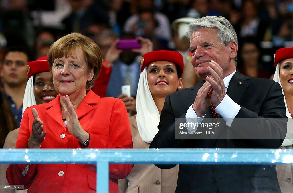 German Chancellor <a gi-track='captionPersonalityLinkClicked' href=/galleries/search?phrase=Angela+Merkel&family=editorial&specificpeople=202161 ng-click='$event.stopPropagation()'>Angela Merkel</a> and German President <a gi-track='captionPersonalityLinkClicked' href=/galleries/search?phrase=Joachim+Gauck&family=editorial&specificpeople=2077888 ng-click='$event.stopPropagation()'>Joachim Gauck</a> celebrate during the award ceremony after the 2014 FIFA World Cup Brazil Final match between Germany and Argentina at Maracana on July 13, 2014 in Rio de Janeiro, Brazil.