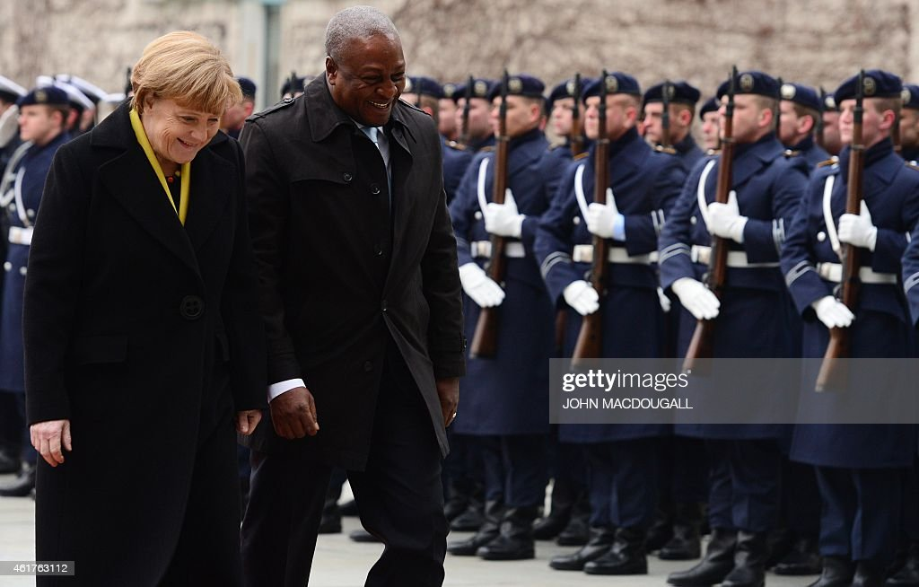 German Chancellor Angela Merkel (L) and Ghana's President <a gi-track='captionPersonalityLinkClicked' href=/galleries/search?phrase=John+Dramani+Mahama&family=editorial&specificpeople=6829053 ng-click='$event.stopPropagation()'>John Dramani Mahama</a> smile as they review an honour guard during a welcoming ceremony at the chancellery in Berlin on January 19, 2015. AFP PHOTO / JOHN MACDOUGALL