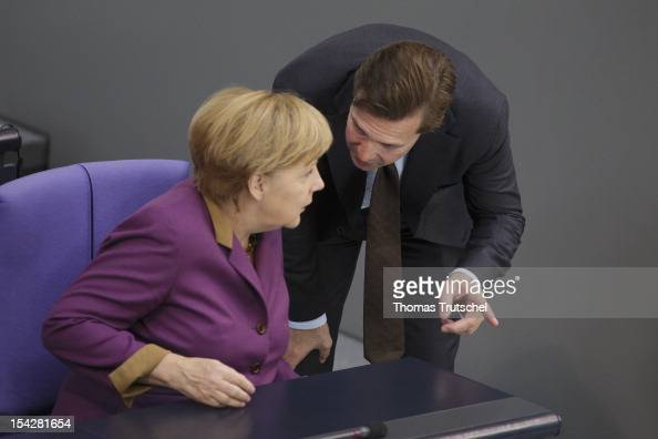 German Chancellor Angela Merkel and Government Spokesman Steffen Seibert during a debate on the antiSemitism report at Reichstag the seat of the...