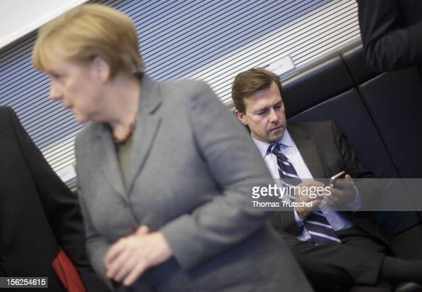 German Chancellor Angela Merkel and Government Spokesman Steffen Seibert are pictured at German Bundestag on November 06 2012