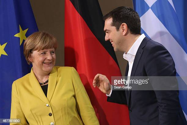 German Chancellor Angela Merkel and Greek Prime Minister Alexis Tsipras depart after speaking to the media following talks at the Chancellery on...