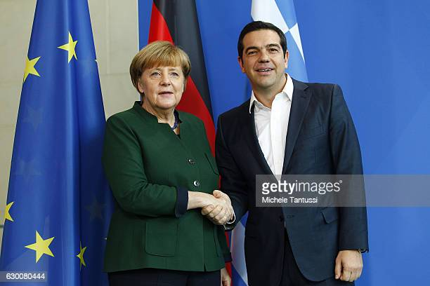 German Chancellor Angela Merkel and Greek Prime Minister Alexis Tsipras shake hands after have spoken to the media prior to talks at the Chancellery...
