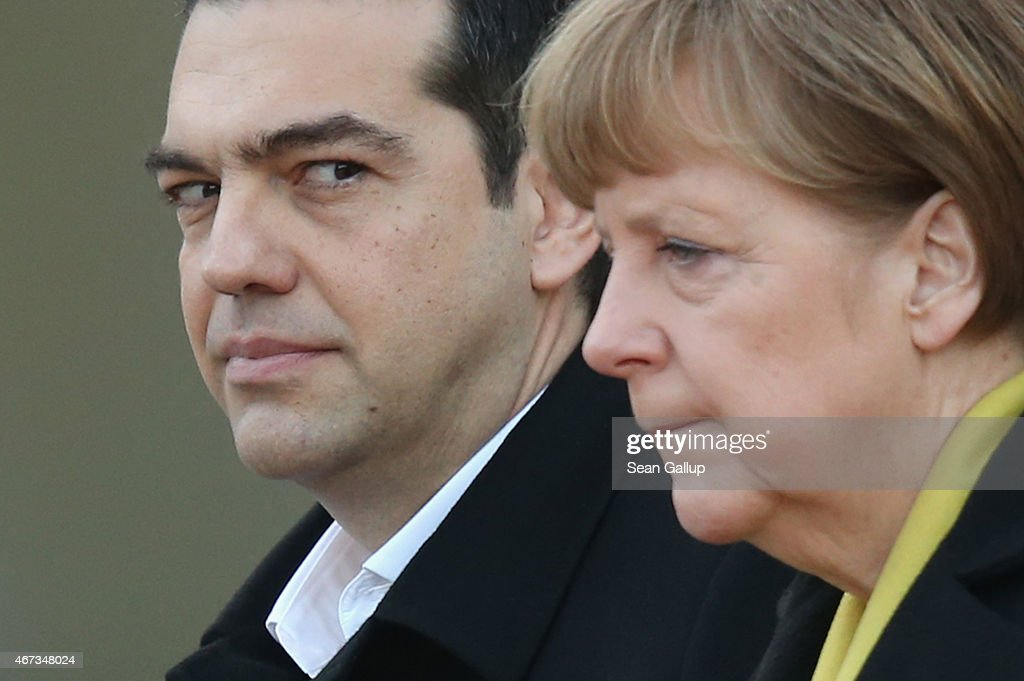 German Chancellor <a gi-track='captionPersonalityLinkClicked' href=/galleries/search?phrase=Angela+Merkel&family=editorial&specificpeople=202161 ng-click='$event.stopPropagation()'>Angela Merkel</a> and Greek Prime Minister <a gi-track='captionPersonalityLinkClicked' href=/galleries/search?phrase=Alexis+Tsipras&family=editorial&specificpeople=6592450 ng-click='$event.stopPropagation()'>Alexis Tsipras</a> listen to their countries' national anthems upon his arrival for talks at the Chancellery on March 23, 2015 in Berlin, Germany. The two leaders are meeting as relations between the Tsipras government and Germany have soured amidst contrary views between the two countries on how Greece can best work itself out of its current economic morass.