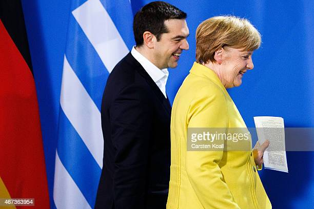German Chancellor Angela Merkel and Greek Prime Minister Alexis Tsipras arrive to speak to the media following talks at the Chancellery on March 23...