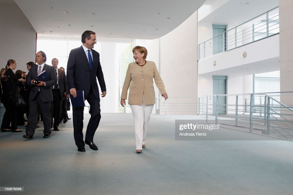 German Chancellor Angela Merkel and Greek Prime Minister Antonis Samaras arrive for a press statement at the Chancellery on August 24, 2012 in Berlin, Germany. Samaras is in Berlin to discuss the conditions of Greece's financial bailout after announcing previously that he is seeking more time for his country to push through required economic reforms in the face of its debt crisis.