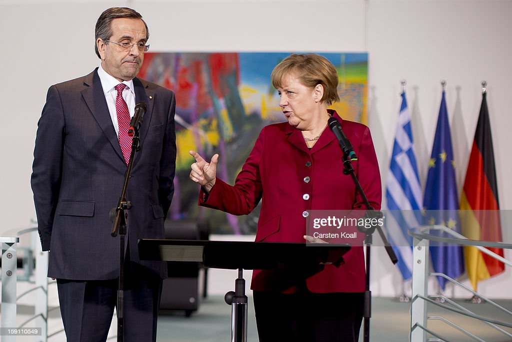 German Chancellor <a gi-track='captionPersonalityLinkClicked' href=/galleries/search?phrase=Angela+Merkel&family=editorial&specificpeople=202161 ng-click='$event.stopPropagation()'>Angela Merkel</a> (R) and Greek Prime Minister <a gi-track='captionPersonalityLinkClicked' href=/galleries/search?phrase=Antonis+Samaras&family=editorial&specificpeople=970799 ng-click='$event.stopPropagation()'>Antonis Samaras</a> give statements to the media following a meeting between the two leaders at the Chancellery on January 8, 2013 in Berlin, Germany. Samaras and Merkel discussed Greece's progress in its economic reforms. Samaras is scheduled to attend an economic conference organized by a German newspaper later in the day.