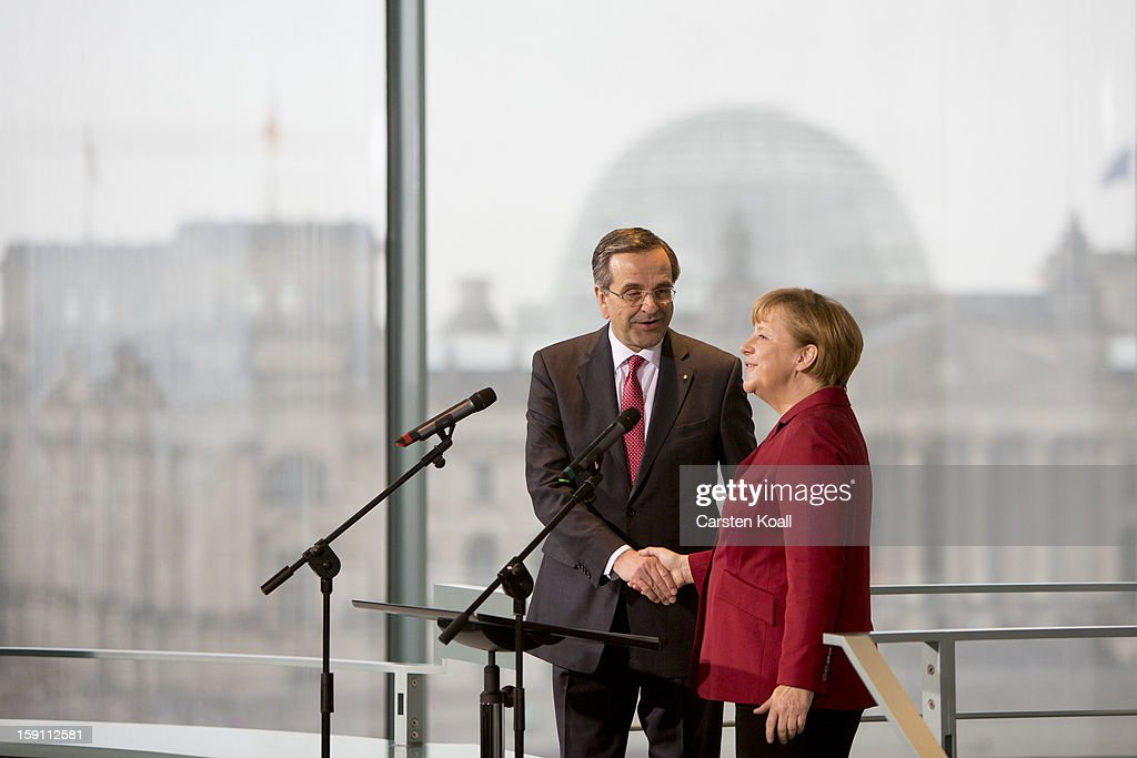 German Chancellor <a gi-track='captionPersonalityLinkClicked' href=/galleries/search?phrase=Angela+Merkel&family=editorial&specificpeople=202161 ng-click='$event.stopPropagation()'>Angela Merkel</a> (R) and Greek Prime Minister <a gi-track='captionPersonalityLinkClicked' href=/galleries/search?phrase=Antonis+Samaras&family=editorial&specificpeople=970799 ng-click='$event.stopPropagation()'>Antonis Samaras</a> shake hands after giving statements to the media following a meeting between the two leaders at the Chancellery on January 8, 2013 in Berlin, Germany. Samaras and Merkel discussed Greece's progress in its economic reforms. Samaras is scheduled to attend an economic conference organized by a German newspaper later in the day.