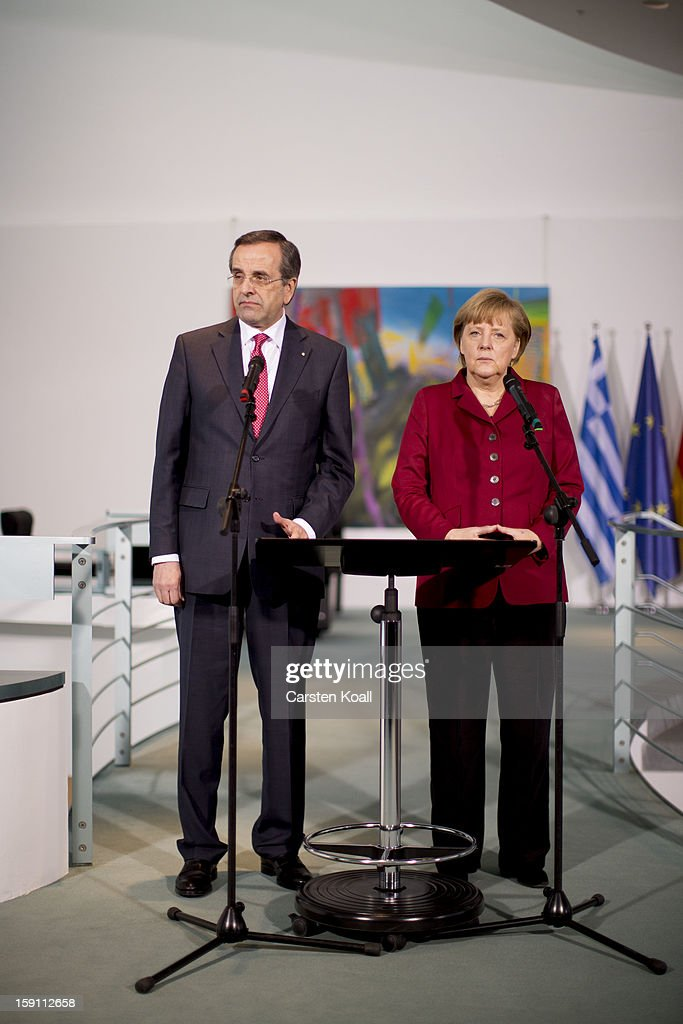 German Chancellor Angela Merkel (R) and Greek Prime Minister Antonis Samaras give statements to the media following a meeting between the two leaders at the Chancellery on January 8, 2013 in Berlin, Germany. Samaras and Merkel discussed Greece's progress in its economic reforms. Samaras is scheduled to attend an economic conference organized by a German newspaper later in the day.
