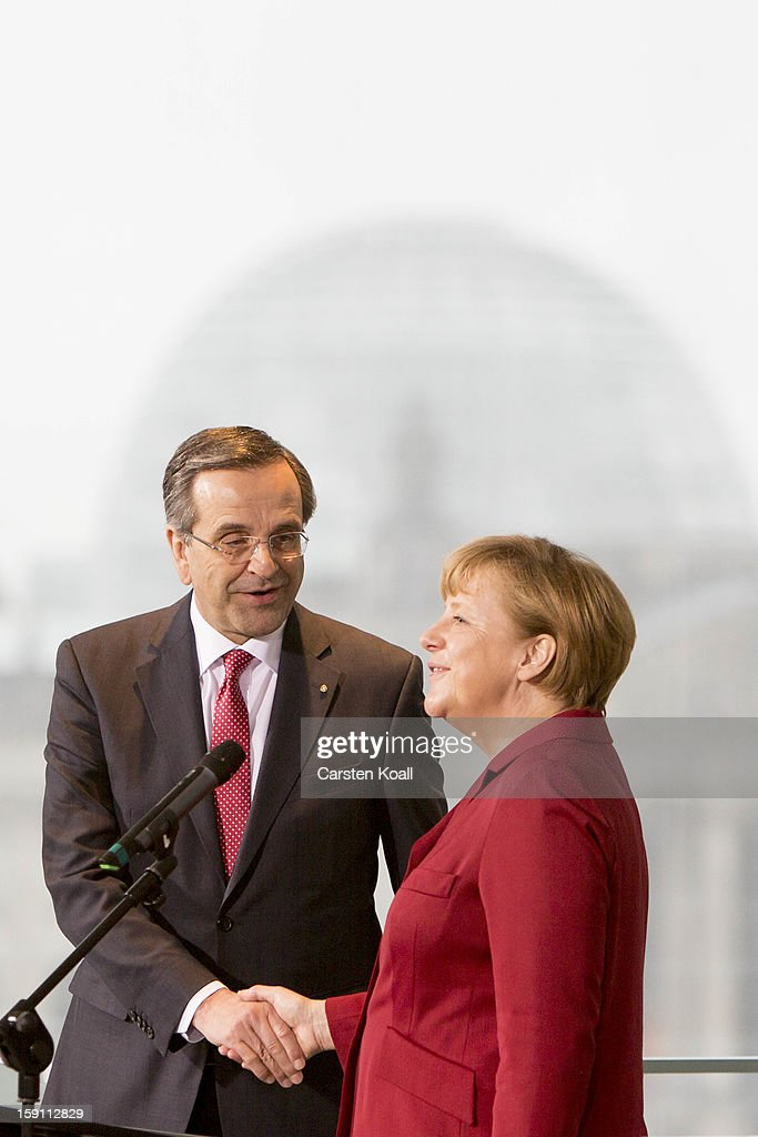 German Chancellor <a gi-track='captionPersonalityLinkClicked' href=/galleries/search?phrase=Angela+Merkel&family=editorial&specificpeople=202161 ng-click='$event.stopPropagation()'>Angela Merkel</a> and Greek Prime Minister <a gi-track='captionPersonalityLinkClicked' href=/galleries/search?phrase=Antonis+Samaras&family=editorial&specificpeople=970799 ng-click='$event.stopPropagation()'>Antonis Samaras</a> shake hands after giving statements to the media following a meeting between the two leaders at the Chancellery on January 8, 2013 in Berlin, Germany. Samaras and Merkel discussed Greece's progress in its economic reforms. Samaras is scheduled to attend an economic conference organized by a German newspaper later in the day.