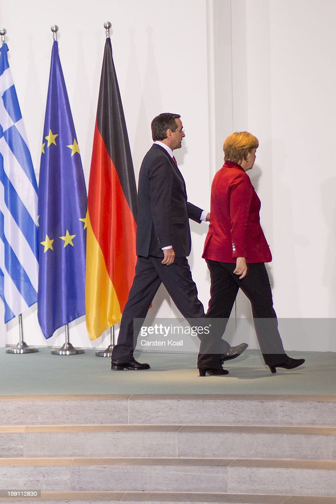 German Chancellor <a gi-track='captionPersonalityLinkClicked' href=/galleries/search?phrase=Angela+Merkel&family=editorial&specificpeople=202161 ng-click='$event.stopPropagation()'>Angela Merkel</a> (R) and Greek Prime Minister <a gi-track='captionPersonalityLinkClicked' href=/galleries/search?phrase=Antonis+Samaras&family=editorial&specificpeople=970799 ng-click='$event.stopPropagation()'>Antonis Samaras</a> leave after giving statements to the media following a meeting between the two leaders at the Chancellery on January 8, 2013 in Berlin, Germany. Samaras and Merkel discussed Greece's progress in its economic reforms. Samaras is scheduled to attend an economic conference organized by a German newspaper later in the day.