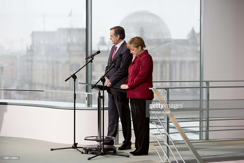 German Chancellor Angela Merkel and Greek Prime Minister Antonis Samaras give statements to the media following a meeting between the two leaders at the Chancellery on January 8, 2013 in Berlin, Germany. Samaras and Merkel discussed Greece's progress in its economic reforms. Samaras is scheduled to attend an economic conference organized by a German newspaper later in the day.