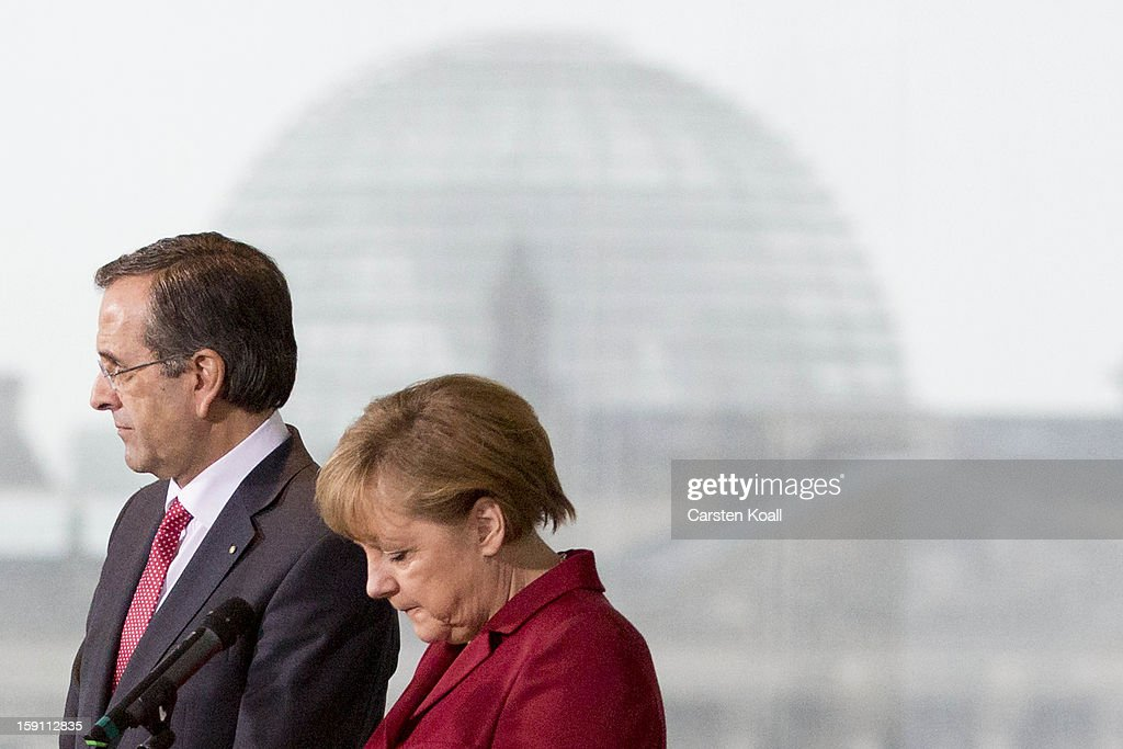 German Chancellor <a gi-track='captionPersonalityLinkClicked' href=/galleries/search?phrase=Angela+Merkel&family=editorial&specificpeople=202161 ng-click='$event.stopPropagation()'>Angela Merkel</a> and Greek Prime Minister <a gi-track='captionPersonalityLinkClicked' href=/galleries/search?phrase=Antonis+Samaras&family=editorial&specificpeople=970799 ng-click='$event.stopPropagation()'>Antonis Samaras</a> give statements to the media following a meeting between the two leaders at the Chancellery on January 8, 2013 in Berlin, Germany. Samaras and Merkel discussed Greece's progress in its economic reforms. Samaras is scheduled to attend an economic conference organized by a German newspaper later in the day.