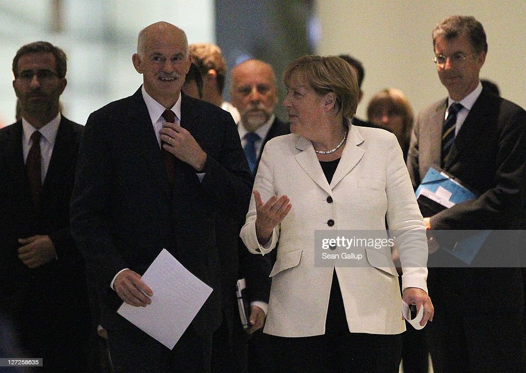 German Chancellor Angela Merkel and Greek Prime Minister George Papandreou arrive to speak to the media prior to talks at the Chancellery on September 27, 2011 in Berlin, Germany. The two leaders are meeting to discuss the current Greek debt crisis that is threatening the stability of the Euro two days before the Bundestag is scheduled to vote on an increase in funding for the European Financial Stability Facility (EFSF).