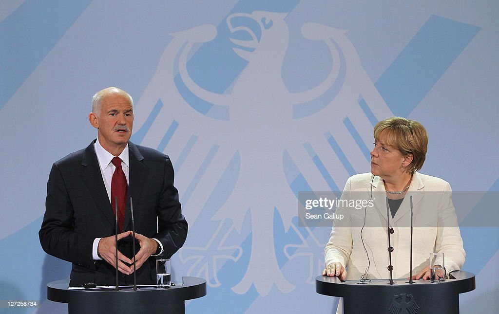 German Chancellor <a gi-track='captionPersonalityLinkClicked' href=/galleries/search?phrase=Angela+Merkel&family=editorial&specificpeople=202161 ng-click='$event.stopPropagation()'>Angela Merkel</a> and Greek Prime Minister George Papandreou speak to the media prior to talks at the Chancellery on September 27, 2011 in Berlin, Germany. The two leaders are meeting to discuss the current Greek debt crisis that is threatening the stability of the Euro two days before the Bundestag is scheduled to vote on an increase in funding for the European Financial Stability Facility (EFSF).