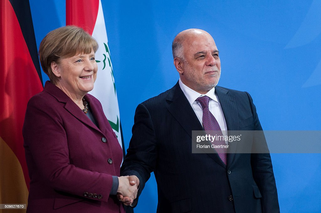 German Chancellor Angela Merkel and Haider al-Abadi, Prime Minister of Iraq, take a handshake after a press conference on February 11, 2016 in Berlin.