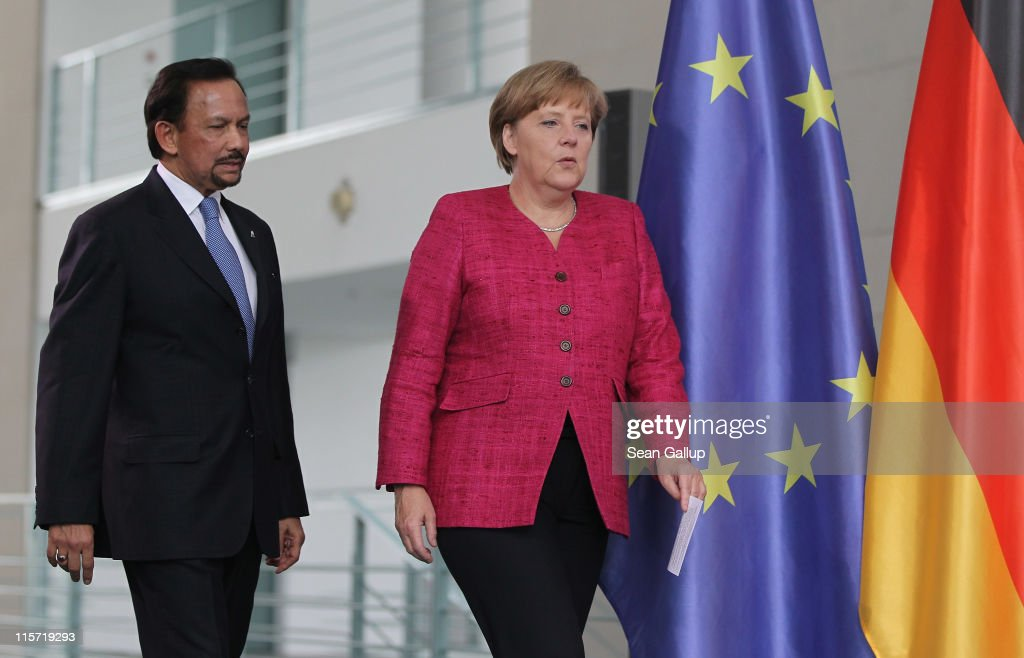 German Chancellor <a gi-track='captionPersonalityLinkClicked' href=/galleries/search?phrase=Angela+Merkel&family=editorial&specificpeople=202161 ng-click='$event.stopPropagation()'>Angela Merkel</a> and Haji Hassanal Bolkiah, the Sultan of Brunei, arrive to give statements to the media following talks at the Cahncellery on June 9, 2011 in Berlin, Germany. The Sultan is on a two-day official trip to Germany.