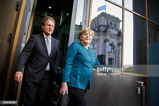 German Chancellor Angela Merkel and Head of the German Chancellery Ronald Pofalla leave after German Social Democrats and German Christian Democrats...