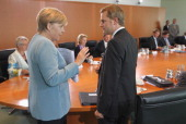 German Chancellor Angela Merkel and Health Minister Daniel Bahr chat prior to the weekly German government cabinet meeting on August 17 2011 in...