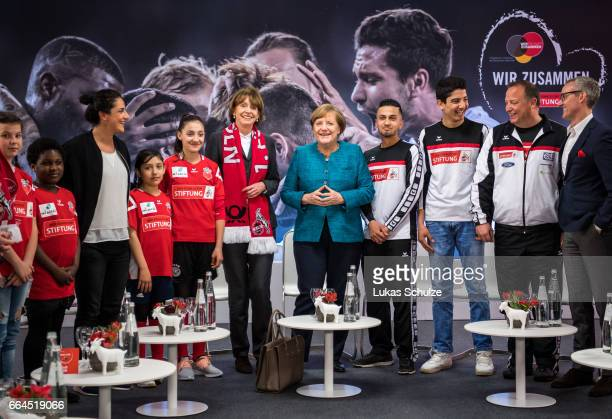 German Chancellor Angela Merkel and Henriette Reker mayor of Cologne meet members of the 1 FC Koeln Foundation and members of the initiative 'Wir...